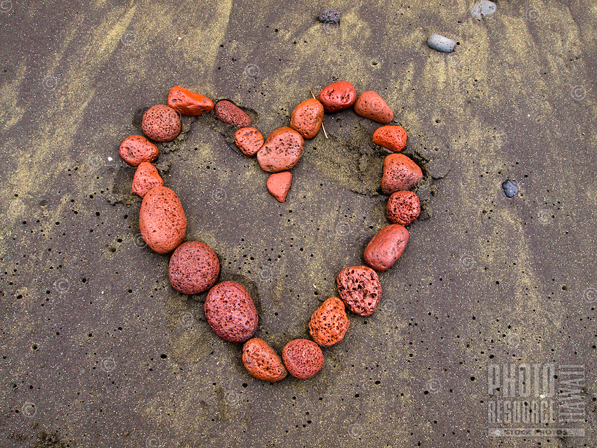 A red heart made on the black sand beach of Pololu Valley, Big Island of Hawai'i.