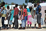 Earthquake survivors crowded into tents and makeshift shelters in a soccer stadium in the Santa Teresa area of Petionville, Haiti, line up for water. Hundreds of thousands of Haitians were left homeless by the January 12 quake.