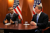 Chicago, IL - December 9, 2008 -- United States President-elect Barack Obama (L) sits with former Vice President Al Gore after a private meeting at Obama's transition office on December 9, 2008 in Chicago, Illinois. Vice President-elect Joe Biden also attended the meeting where an Obama spokesman said the three men discussed energy and climate change and how policies in those areas could help the economy. .Credit: Brian Kersey - Pool via CNP