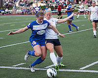 Boston Breakers midfielder Maddy Evans (18) and Sky Blue FC defender Kendall Johnson (5) battle for the ball near the Sky Blue goal.  In a National Women's Soccer League Elite (NWSL) match, Sky Blue FC defeated the Boston Breakers, 3-2, at Dilboy Stadium on June 16, 2013