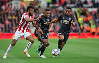 Luis Antonio Valencia (centre) with Eric Maxim Choupo-Moting of Stoke City & Anthony Martial of Man Utd during the Premier League match between Stoke City and Manchester United at the Britannia Stadium, Stoke-on-Trent, England on 9 September 2017. Photo by Andy Rowland.