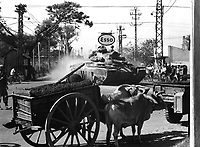 Tank from 1st Bn., 69th Armor, 25th Inf. Div., moves through Saigon shortly after disembarking from LST at Saigon Harbor, March 12, 1966.  SP/5 Park, USA.  (USIA)<br /> NARA FILE #:  306-MVP-25-1<br /> WAR & CONFLICT BOOK #:  419