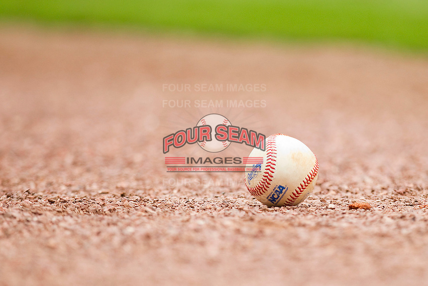 An NCAA baseball sits on the gravel area in front of the visitors dugout at Minute Maid Park on March 4, 2011 in Houston, Texas.  Photo by Brian Westerholt / Four Seam Images