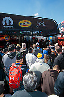 Feb 23, 2019; Chandler, AZ, USA; Fans surround the pit area of NHRA top fuel driver Leah Pritchett as she warms up her car during qualifying for the Arizona Nationals at Wild Horse Pass Motorsports Park. Mandatory Credit: Mark J. Rebilas-USA TODAY Sports