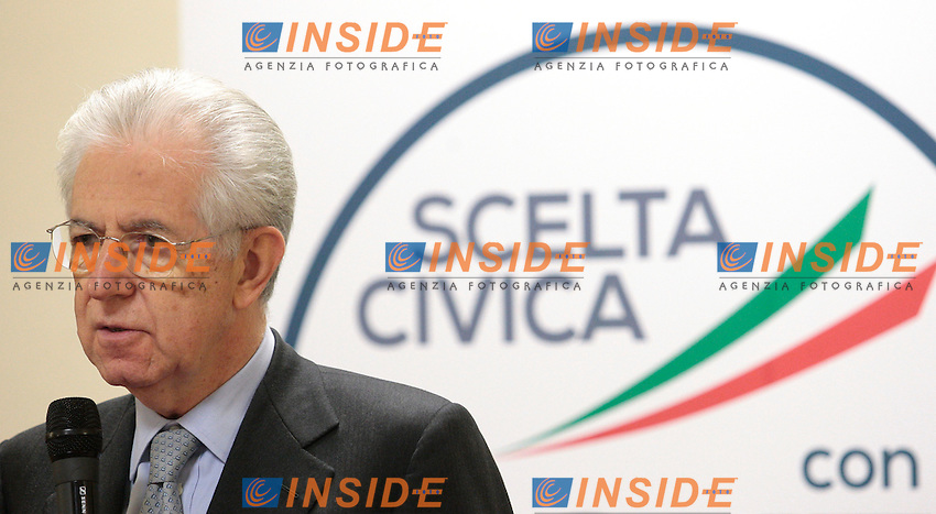Mario Monti .Roma 15/02/2013 Presentazione del programma per lo sport della Scelta Civica Monti per l'Italia..The italian premier presents his program for sport for the next elections 2013 and candidate two of the best athlets in the world at the past olympic and paralympic games. .Photo Samantha Zucchi Insidefoto