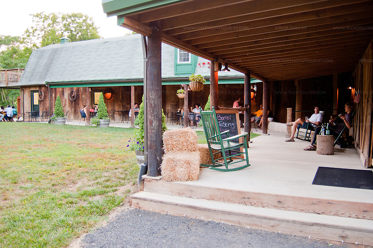 A shaded porch offers places to sit and enjoy wine and music, at the back of Dry Mill Winery.