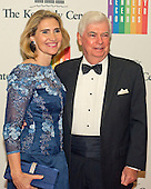 Former United States Senator Christopher J. Dodd (Democrat of Connecticut), who currently serves as the Chairman and CEO of the Motion Picture Association of America, and his wife, Jackie Clegg, arrive for the formal Artist's Dinner honoring the recipients of the 2013 Kennedy Center Honors hosted by United States Secretary of State John F. Kerry at the U.S. Department of State in Washington, D.C. on Saturday, December 7, 2013. The 2013 honorees are: opera singer Martina Arroyo; pianist,  keyboardist, bandleader and composer Herbie Hancock; pianist, singer and songwriter Billy Joel; actress Shirley MacLaine; and musician and songwriter Carlos Santana.<br /> Credit: Ron Sachs / CNP
