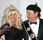 """Katie Couric and Billy Crystal  attending Bette Midler's New York Restoration Project's Annual """"Hulaween in the Big Easy"""" at  the Waldorf Astoria on October 31, 2013  in New York City."""
