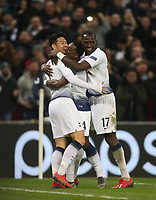 Tottenham Hotspur's Son Heung-Min celebrates scoring his side's first goal with Serge Aurier and Moussa Sissoko<br /> <br /> Photographer Rob Newell/CameraSport<br /> <br /> UEFA Champions League Round of 16 First Leg - Tottenham Hotspur v Borussia Dortmund - Wednesday 13th February 2019 - Wembley Stadium - London<br />  <br /> World Copyright © 2018 CameraSport. All rights reserved. 43 Linden Ave. Countesthorpe. Leicester. England. LE8 5PG - Tel: +44 (0) 116 277 4147 - admin@camerasport.com - www.camerasport.com