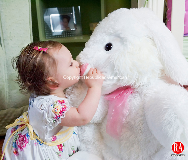 WATERBURY, CT- 18 MARCH 2008- 031808JT03-<br /> Grace Rogers, 14-months-old, kisses with a toy Easter bunny at her Waterbury home on Tuesday.<br /> Josalee Thrift / Republican-American