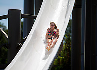 NWA Democrat-Gazette/JASON IVESTER<br /> Alexis Marvin, 17, of Fayetteville slips down one of the slides Monday, May 29, 2017, at the Rogers Aquatic Center.
