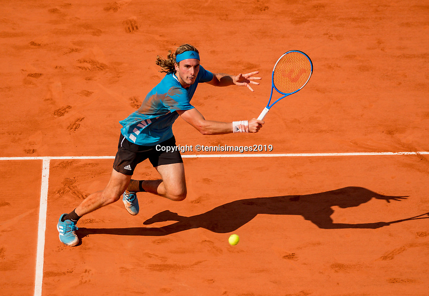 Paris, France, 2 june, 2019, Tennis, French Open, Roland Garros, Stefanos Tsitsipas (GRE) in action against Wawrinka (SUI)<br /> Photo: Henk Koster/tennisimages.com