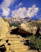 Step trail near Moraine Lake with Pinnacle Mountain in clouds. Banff National Park, Alberta Canada