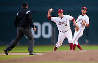 STANFORD, CA - March 25, 2011: Eric Smith of Stanford baseball turns a double play during Stanford's game against Long Beach State at Sunken Diamond. Stanford lost 6-3.