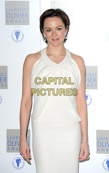 RACHEL STIRLING.The Laurence Olivier Awards 2010, Grosvenor House Hotel, London, England. .21st March 2010 .half 3/4 length white dress sleeveless Rachael.CAP/BEL.©Tom Belcher/Capital Pictures.