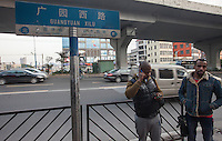 Africans are seen by the road in an area of Guangzhou known to locals as 'Chocolate City', Guangzhou, Guangdong Province, China, 08 December 2014. The health authorities of Guangzhou are said to be stepping up their monitoring of the African community in light of the ongoing outbreak of the Ebola virus disease in West Africa.