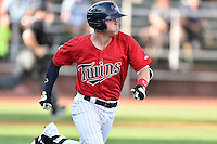 Elizabethton Twins left fielder Shane Carrier (8) runs to first base during a game against the Bristol Pirates at Joe O'Brien Field on July 30, 2016 in Elizabethton, Tennessee. The Twins defeated the Pirates 6-3. (Tony Farlow/Four Seam Images)