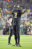 Baylor defensive end Shawn Oakman (2) asks the fans to make noise during second half of an NCAA football game, Saturday, November 22, 2014 in Waco, Tex. Baylor defeated Oklahoma State 49-28. (Mo Khursheed/TFV Media via AP Images)