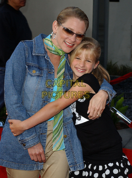 JENNA BOYD & DEBBIE BOYD (MOTHER).Attending the world premiere of Mean Girls at the Cinerama Dome, Hollywood, California..April 19th 2004.fringe black and white t-shirt ponytail polka dot ruffle ra ra skirt flip flops sandals hugging family smiling half length half-length.*UK sales only*.www.capitalpictures.com.sales@capitalpictures.com.©Capital Pictures