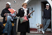 Labour MP and former minister Margaret Hodge campaigning in Dagenham, East London. Here, she hands out election leaflets to a prospective voter. A neighbour, who refused the leaflets, looks on.