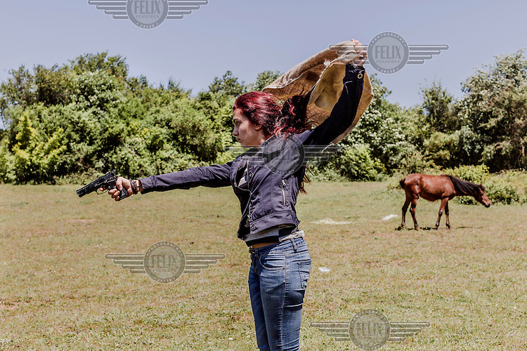 A horse grazes undisturbed as an actor pulls a pistol during filming of 'Oyle Bir Gecer Zaman Ki' (As Time Goes By), one of the most loved and most watched Turkish Soap Operas in the Middle East and North Africa.