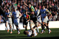 Jack Clifford of Harlequins breaks through the tackle of Andrew Fenby of London Irish during the Aviva Premiership Rugby match between Harlequins and London Irish at The Twickenham Stoop on Saturday 7th March 2015 (Photo by Rob Munro)
