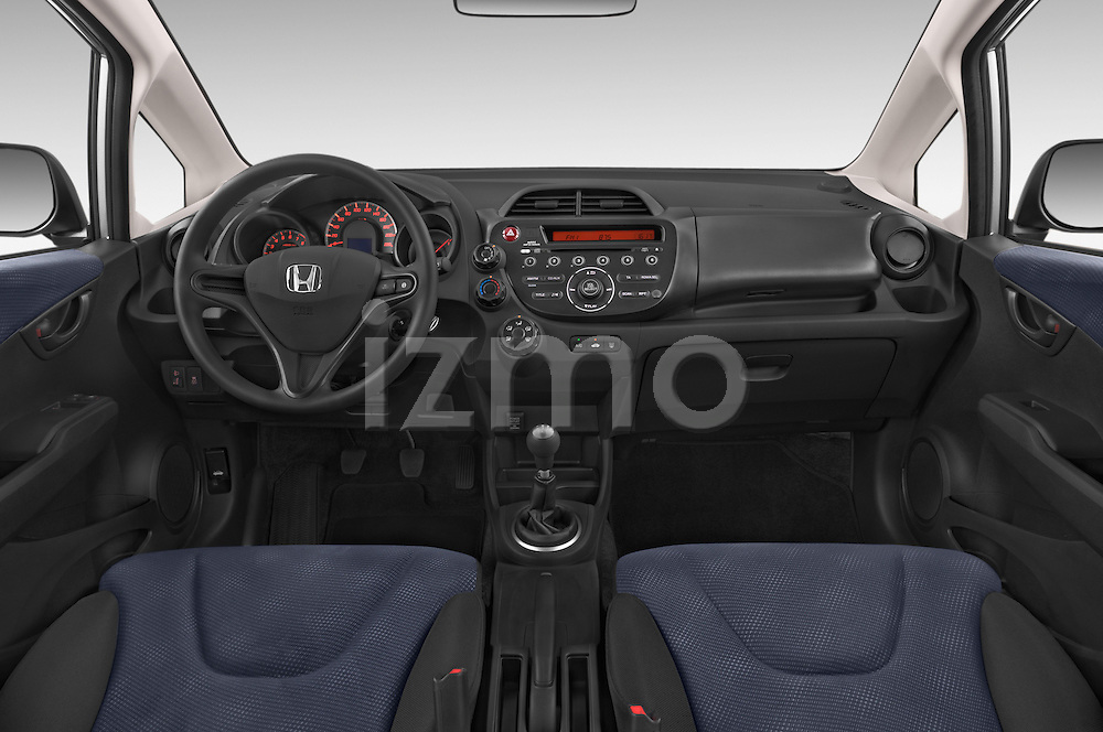 Stock photo of straight dashboard view of a 2014 Honda Jazz s 5 Door Hatchback 2WD Dashboard