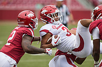Hawgs Illustrated/BEN GOFF <br /> Kamren Curl (2), Arkansas safety, helps tackle wide receiver Koilan Jackson in the third quarter Saturday, April 6, 2019, during the Arkansas Red-White game at Reynolds Razorback Stadium.
