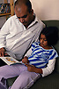 Father and daughter reading a book,