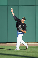 Alex Liddi (10) of the Charlotte Knights makes a throw from the outfield during fielding practice prior to the game against the Gwinnett Braves at BB&T Ballpark on April 16, 2014 in Charlotte, North Carolina.  The Braves defeated the Knights 7-2.  (Brian Westerholt/Four Seam Images)