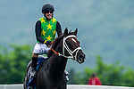 HONG KONG - MAY 04:  Anton Marcus of South Africa riding Varity Club celebrates after wining The Champions Mile at Sha Tin racecourse on May 4, 2014 in Hong Kong, Hong Kong.  Photo by Aitor Alcalde / Power Sport Images