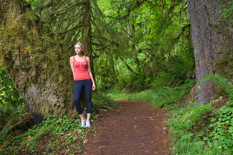 Young woman hiking at Silver Falls State Park. Oregon