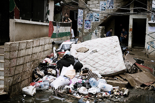 Palestinian men in the camp of Burj el Barajneh, south of Beirut, Lebanon. Some areas of the camp are undergoing sewage stystem repairs, financed by the UNRWA.<br /> <br /> Dans le d&eacute;dales des ruelles du camp palestinien de Burj El Barajneh, au sud de Beyrouth
