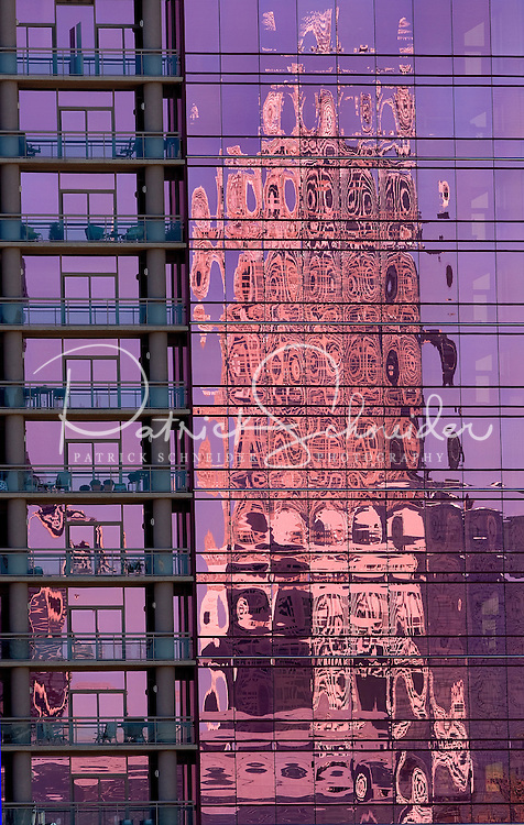 A high rise reflects in a the glass of a neighboring tower in Charlotte, NC.