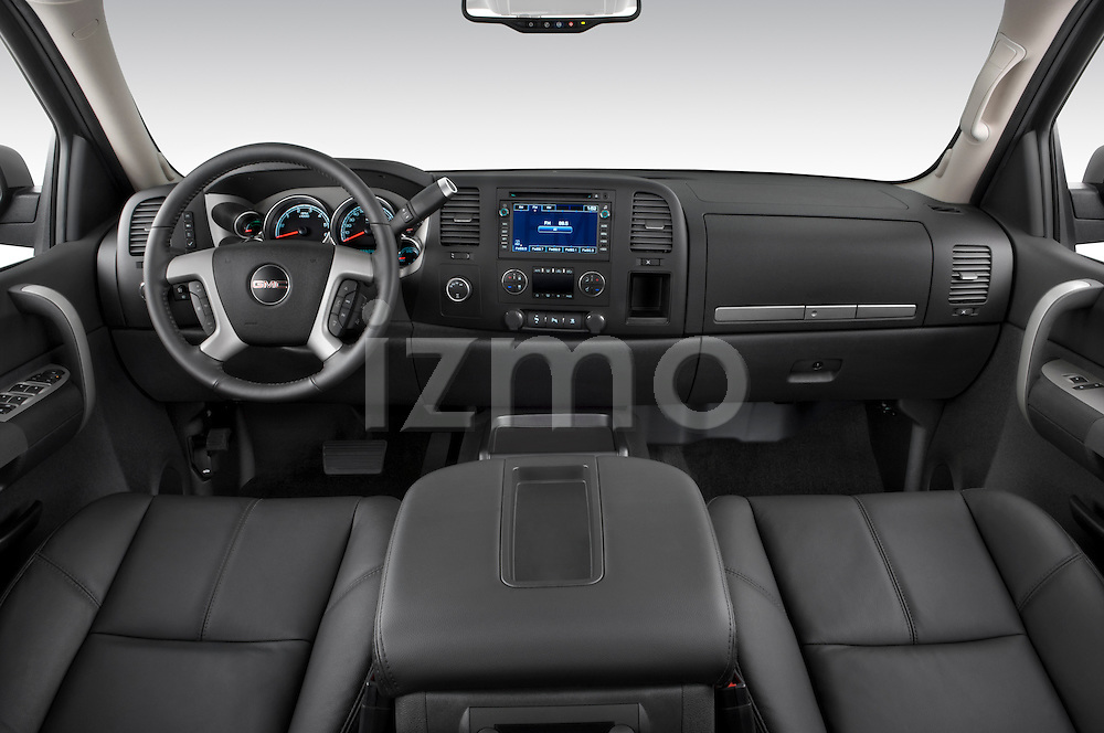 Straight dashboard view of a 2009 GMC Sierra Hybrid.