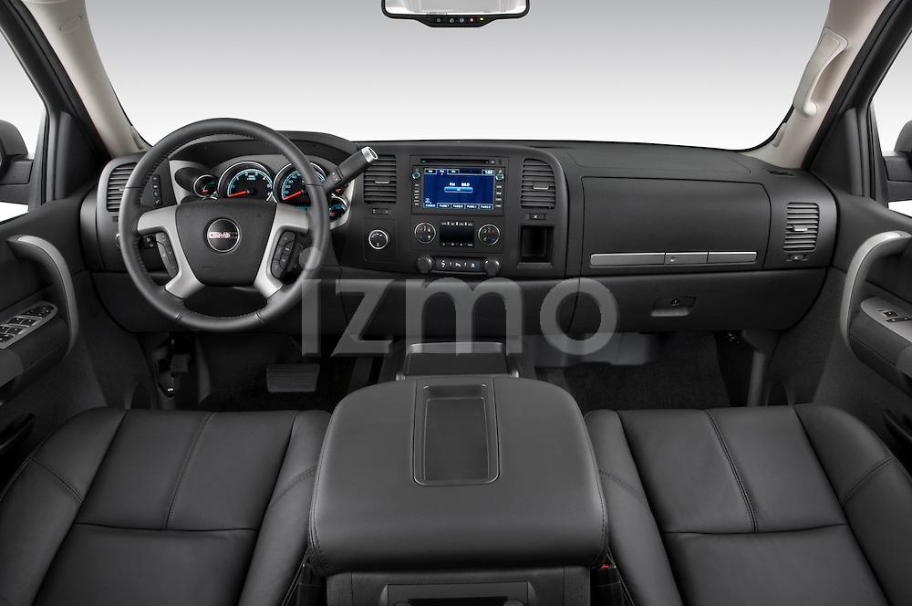 Straight dashboard view of a 2009 GMC Sierra Hybrid.