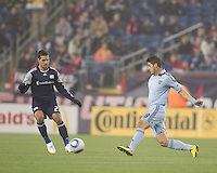 Sporting Kansas City midfielder Milos Stojcev (88) passes the ball as New England Revolution midfielder Benny Feilhaber (22) defends. In a Major League Soccer (MLS) match, the New England Revolution defeated Sporting Kansas City, 3-2, at Gillette Stadium on April 23, 2011.