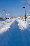 Idaho, Coeur d' Alene. A long straight stretch of sidewalk through deep snow.
