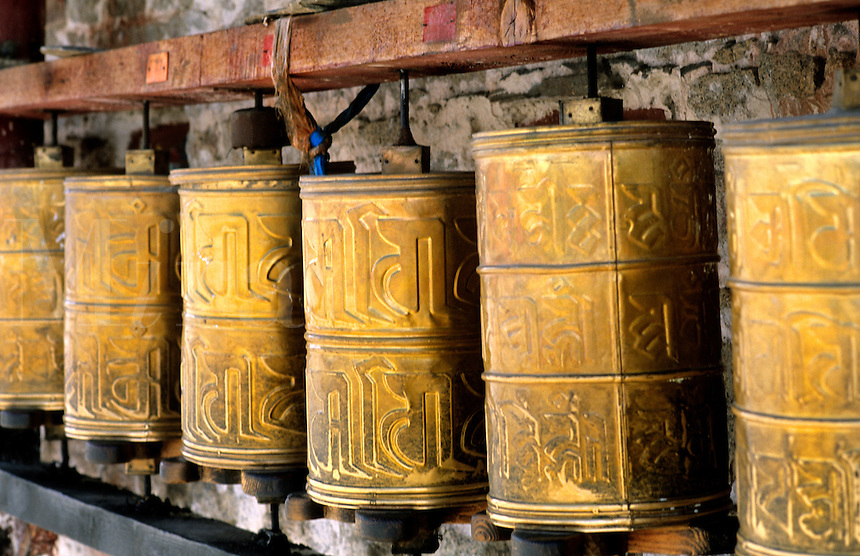 Prayer wheels brass at the wonderful Potala Palace the home of the Dalai Lama in capital city of Lhasa Tibet China