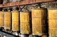 Prayer wheels brass at the wonderful Potala Palace the home of the Dalai Lama in capital city of Lhasa Tibet China