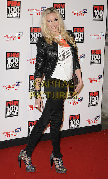 NOELLE RENO.The FHM 100 Sexiest Women for 2011 party, One Marylebone Rd., London, England..May 4th, 2011.full length black jeans denim sandals jacket white top clutch bag side  .CAP/CAN.©Can Nguyen/Capital Pictures.