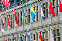 A few of the many flags of nations on the exterior of the Town Hall of Antwerp in Grote Markt, Antwerp, Belgium