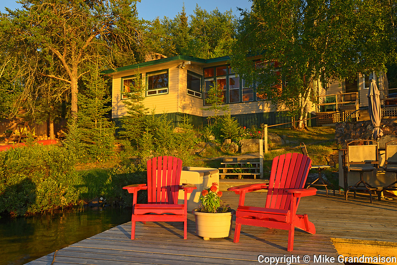 Muskoka chairs and cottage at Star Lake<br />