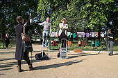 Tony Allen and Heiko Khoo address the press at the opening of the newly re-landscaped speaking area at Speakers' Corner, Hyde Park, London.