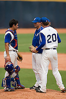19 August 2007: Team manager Jeff Zeilstra talks with catcher Boris Marche and pitcher Gregory Cros during the Japan 4-3 victory over France in the Good Luck Beijing International baseball tournament (olympic test event) at the Wukesong Baseball Field in Beijing, China.