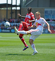 New York defender Jan Gunnar Solli (8) clears the ball in front of Chicago midfielder Patrick Nyarko (14).  The Chicago Fire tied the New York Red Bulls 1-1 at Toyota Park in Bridgeview, IL on June 26, 2011.