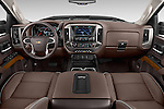 Stock photo of straight dashboard view of 2016 Chevrolet Silverado 2500Hd High Country 4 Door Pick Up Dashboard