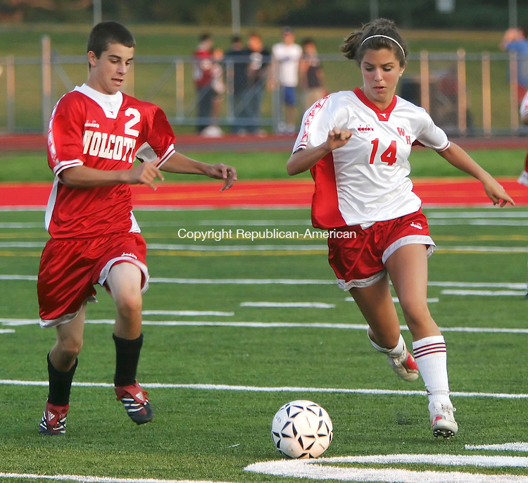 WOLCOTT, CT, 07 SEPTEMBER 2006, 090706BZ04-  Wolcott High School soccer players Rob Garrigas, 14, gr. 10, and Kelsey Skura, 14, gr. 10,  play an exhibition game on the brand new artificial turf field after it was unveiled to the public Thursday.<br />  Jamison C. Bazinet Republican-American