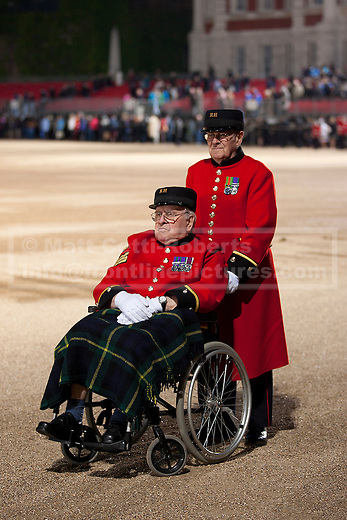 13/06/2012. LONDON, UK. Two Chelsea Pensioners wait to leave Horse Guards Parade after the annual Beating Retreat parade. On two successive evenings each year in June a pageant of military music, precision drill and colour takes place on Horse Guards Parade in the heart of London when the Massed Bands of the Household Division carry out the Ceremony of Beating Retreat. 300 musicians, drummers and pipers perform this age-old ceremony. The Retreat has origins in the early days of chivalry when beating or sounding retreat pulled a halt to the days fighting. Photo credit: Matt Cetti-Roberts