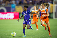 Orlando, Florida - Saturday, April 23, 2016: Orlando Pride forward Jasmyne Spencer (23) is chased by Houston Dash forward Janine Beckie (11) during an NWSL match between Orlando Pride and Houston Dash at the Orlando Citrus Bowl.